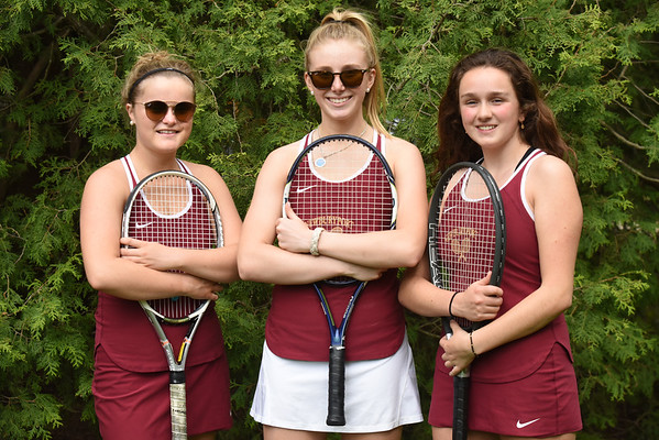 BRYAN EATON/Staff Photo. Newburyport High tennis single's player, from left, Sophie Page, River Sava and Ann deKanter.
