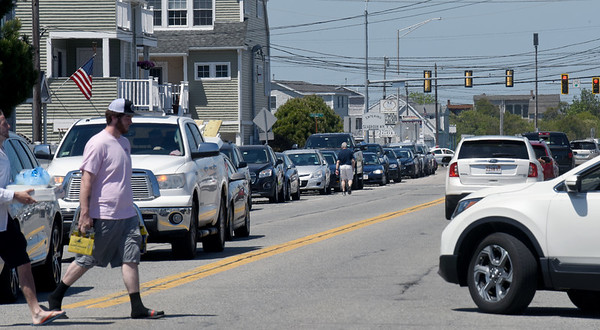 BRYAN EATON/Staff photo. Cars were lined up on North End Boulevard at Salisbury Beach, south of the Seabrook town line, as people thronged to the beaches. There was a small amount of vehicles with New Hampshire tags, but not overwhelming so/