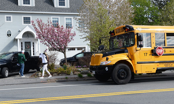 BRYAN EATON/Staff photo. The school bus making the West Newbury rounds stops at graduating senior Sophie Beauparlant's home on West Main Street.