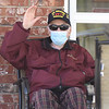 BRYAN EATON/Staff photo. Bill Dziadosz waves to the fire and police departments as they drive by Country Center for Health & Rehabilitation where he has lived for several years.