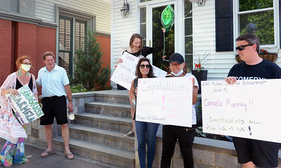 BRYAN EATON/Staff photo. Family and friends of the late Michael Colby, a Newburyport High graduate and artist who did work for Nike, MTV and other companies, gathered to present the Michael Colby Art Scholarship for $2,000 to graduating senior Carmela Murphy at her Brown Square home escorted by police and fire members.
