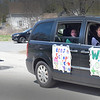 BRYAN EATON/Staff photo. A dozen cars filled with Pentucket School District staff and students were escorted by Merrimac Fire and Police vehicles around town in a parade passing by teachers' homes with horns blaring, with messages on the sides of cars showing apprecition on Tuesday afternoon. In the morning they also toured around Groveland, then later West Newbury.