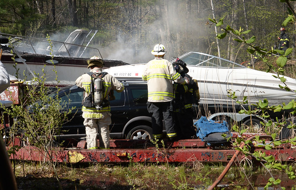 BRYAN EATON/Staff photo. Salisbury firefighters and crews from surrounding town responded to two boats on fire at 48 Rabbit Road on Wednesday afternoon. The boat storage yard goes behind Paul's Auto Body and Glass, Rabbit Road being closed from Baker Road to Old Elm Street while crews worked to make sure the fires were out.