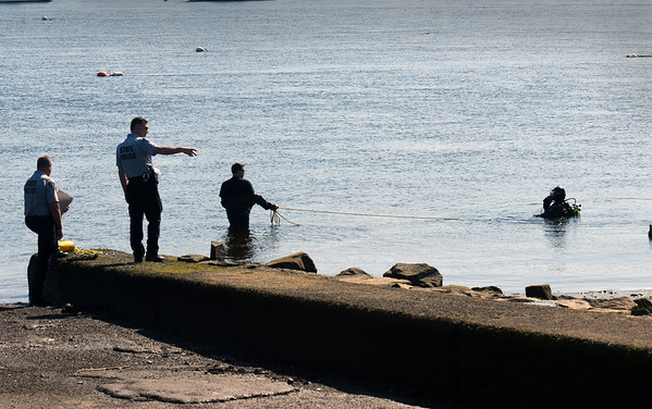 BRYAN EATON/Staff photo. Boaters and passersby may have been wondering what all the Mass. State Police presence was at Cashman Park on Wednesday morning. They were doing scuba line rescue from one of the ramps, training twice a month to remain fresh.