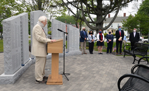 BRYAN EATON/Staff photo. Former Salisbury selectman Fred Knowles introduces the present day board and town manager before leading the few in attendance in the Pledge of Allegiance in a scaled down Memorial Day observance.