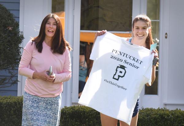 BRYAN EATON/Staff photo. Cassandra Plisinski, with her mom, Robin, pose as Pentucket school staff take their photo.