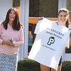 BRYAN EATON/Staff photo. Cassandra Plisinski, with her mom, Robin, pose as Pentucket school staff take their photo.