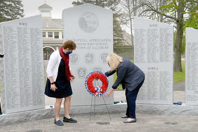 BRYAN EATON/Staff photo. The Salisbury board of selectmen held a small-scale Memorial Day observance on the town common on Saturday. Two board members, Ronalee Ray-Parrott, left, and Wilma McDonald laid a wreath at the Veterans Memorial followed by some words from town manager Neil Harrington.