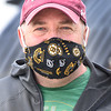BRYAN EATON/Staff photo. Former First Essex District state representative Michael Costello of Newburyport sports a Boston Bruins mask a friend made for him.