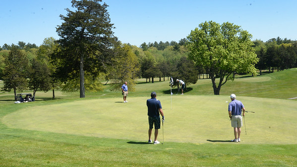 BRYAN EATON/Staff photo. One foursome putts on  the second green at the Ould Newbury Golf Club.