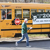 BRYAN EATON/Staff photo. Dan Thornton and other Pentucket High School staff and parents get off the bus to celebrate seniors with t-shirts, here at the home of Kelly Atwood.