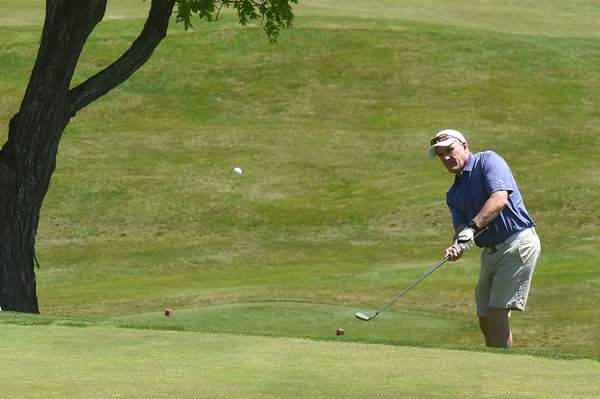 BRYAN EATON/Staff photo. Patrick Tobin of Danvers hits a chip shot on the second green at Ould Newbury Golf Club on Tuesday afternoon.