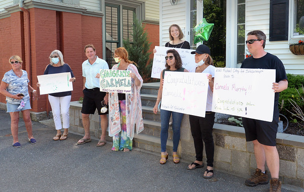 BRYAN EATON/Staff photo. Family and friends of the late Michael Colby, a Newburyport High graduate and artist who did work for Nike, MTV and other companies, gathered to present the Michael Colby Art Scholarship for $2,000 to graduating senior Carmela Murphy, at top, at her Brown Square home escorted by police and fire members.