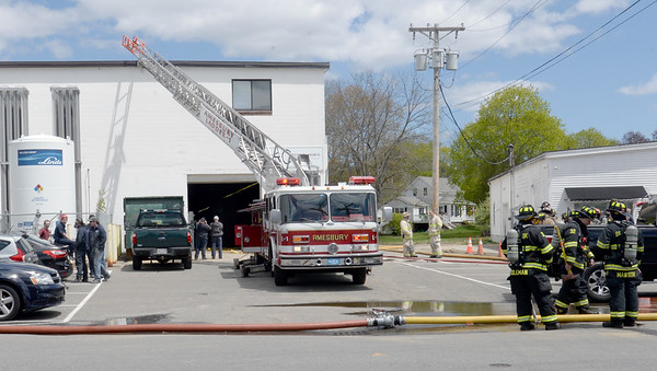 BRYAN EATON/Staff photo. Fire departments from the area assisted the Amesbury Fire Department as they investigated a possible chemical fire at ARC Technologies at 144 Elm Street in Amesbury early Tuesday afternoon. Employees were evacuated as firefighters investigated in this view from Oakland Street.