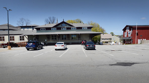 BRYAN EATON/Staff photo. The parking deck at Amesbury's Upper Millyard, Crave Restaurant is to the left, and the Barn Pub and Grill to the right.