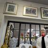 BRYAN EATON/Staff photo. artist Karen Fitzgerald with some of her artwork above at Vintage Chic in Newburyport.