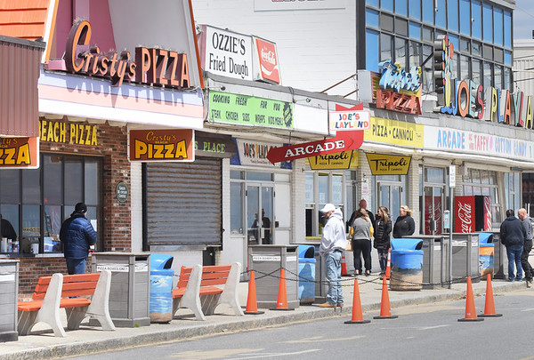 BRYAN EATON/Staff photo. Cristy's and Tripoli's pizza shops reopened this weekend at Salisbury Beach, though with it being Mother's Day on Sunday and very windy the usual crowds weren't there.