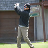 BRYAN EATON/Staff photo. Andrew Langlois of South Hampton, N.H. tees off at the Amesbury Country Club.