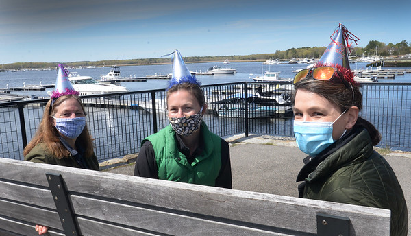 BRYAN EATON/Staff photo. Sporting birthday hats Alison Ratcliffe, left, and daughters Whitney Roy, both of Eliot, Maine and Thea Church, right, of Norwood, spent time on Newburyport's Harborwalk Rail Trail. It was Ratcliffe's birthday and they picked Newburyport as a halfway point and to visit her sister, Cornelia Walsh, who lives in Newburyport.