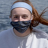 BRYAN EATON/Staff photo. Emily Dobson of Newburyport wears a mask her mother's friend procured for family members as she and some friends spend time on the Mayor Peter Matthews Boardwalk in Newburyport.