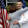 BRYAN EATON/Staff photo. Ensign Michael Denner gets a hug from his mother Michelle Denner Duratti.