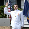 BRYAN EATON/Staff photo. Michael Denner of Newburyport is sworn in online as an ensign in the U.S. Navy on Sunday morning in front of family, friends and neighbors. He graduated from Norwich University in the ROTC program on Saturday, but the graduation ceremony won't be until September at which point he'll likely be deployed.
