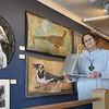 BRYAN EATON/Staff photo. Artist Paula Estey at her gallery on Harris Street in Newburyport.