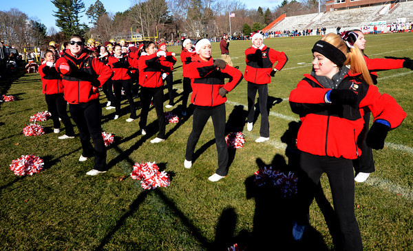 Newburyport: Amesbury cheerleaders lead a cheer at the Thanksgiving fottball game between Newburyport and Amesbury at World War Memorial Stadium in Newburyport Thursday. Jim Vaiknoras/staff photo