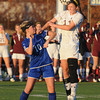 Worcester: Newburyport's Carly Brand heads the ball with Granby's Tara Mikalchus during their game at Foley Stadium in Worcester. The Clipper's won the game 1-0, giving them the Division 3 State Championship. Jim Vaiknoras/staff photo