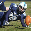 Byfield: Triton's Luke Boyle recovers a fumble from Pentucket's Darren Engelke. Bryan Eaton/Staff Photo