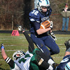Byfield: Triton's Luke Boyle gains some yards in Byfield yesterday. Bryan Eaton/Staff Photo