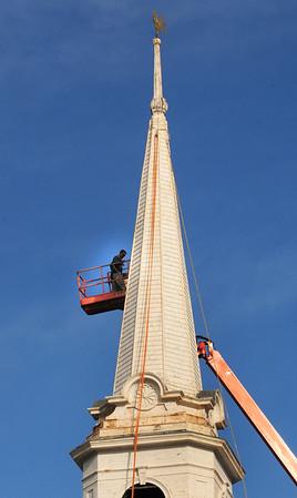 BRYAN EATON/Staff Photo. Repairs and painting are being made to the First Parish Church of Newbury.