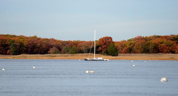 JIM VAIKNORAS/Staff photo A lonely sailboat rest in the Merrimack River near Cashman Park in Newburyport.