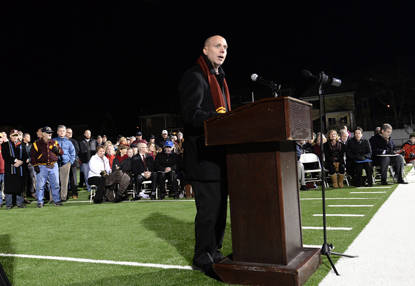 BRYAN EATON/Staff Photo. Michael Jones, president and CEO of the Institutions For Savings which made a sizable donation to the stadium project speaks to the crowd. He and the trustees conferred their naming rights to the new field to Jim Stehlin.