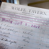 BRYAN EATON/Staff photo. A guest ledger from 1897 for Newburyport's Wolfe Tavern which was demolished in 1954.