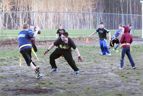BRYAN EATON/Staff photo. Youngsters practice in intramural football in the afterschool program at Salisbury Elementary School on Thursday. They will be competing in the Williams Bowl Thanksgiving Game next Wednesday.