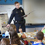 BRYAN EATON/Staff photo. Rowley police officers Patrick McGettrick, pictured, and Sheri David speak to sixth-graders at the Pine Grove School in Rowley in a program called