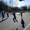 BRYAN EATON/Staff photo. Sixth-graders at Newbury Elementary School cast shadows during a game of basketball on Monday afternoon. It was perfect weather for being out for recess this time of year.