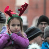 "JIM VAIKNORAS/Staff photoA girl with reindeer antlers on acts out the line ""he knows when you are sleeping "" from Santa Claus is Coming to Town at  the annual tree lighting in Market Square In Newburyport Sunday."