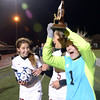 JIM VAIKNORAS/Staff photo Newburport girls soccer goalie Jen Stuart holds the North Sectional Trophy at the Manning Field in Lynn Saturday night.