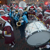 JIM VAIKNORAS/Staff photo The Newburyport High School and Triton High School band perform at the annual tree lighting in Market Square In Newburyport Sunday.