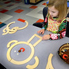 BRYAN EATON/Staff photo. Ella Caldwell, 4, uses geometric shapes to create a snowman at Newburyport's Bresnahan School on Monday. She was in Susan Simon's pre-kindergarten class during choice time.