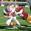 JIM VAIKNORAS/Staff photo Newburyport's Noah Van Schalkwyk breaks up a pass intended for Amesbury's Patrick Birmingham at the Newburyport/Amesbury Thanksgiving football game at World War Memorial Stadium in Newburyport Thursday.