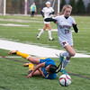 JIM VAIKNORAS/Staff photo Newburyport's Kelsey Soule collides with an East Boston player Saturday at World War Memorial Stadium in Newburyport. The Clippers won the game 12-0.