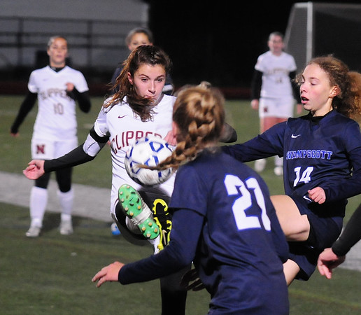 JIM VAIKNORAS/Staff photo Newburyport's Margaret Cote clears the ball against Swampscott at Manning Field in Lynn Sunday Night.