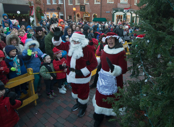 JIM VAIKNORAS/Staff photo Santa and Mrs. Claus arrive at the annual Santa Parade and Tree Lighting in Market Square in Newburyport Sunday.