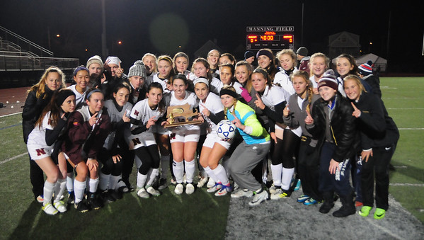 JIM VAIKNORAS/Staff photo The Newburyport girls soccer team pose with their trophy after defeating Swampscott to claim the North Sectional championship at Manning Field in Lynn Sunday Night.