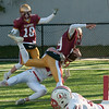 JIM VAIKNORAS/Staff photo Newburyport's Connor Skane dives into the endzone for 2 points at the Newburyport/Amesbury Thanksgiving football game at World War Memorial Stadium in Newburyport Thursday.
