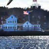 BRYAN EATON/Staff photo. A west wind whips up the waves on the Merrimack River and blows the flags at Newburyport Harbormaster's headquarters and the Custom House Maritime Museum on Monday afternoon making the 40 degree temperature seem colder. A slight warmup is in the forecast for today and tomorrow, with sun on Thanksgiving, but cooler temperatures again.
