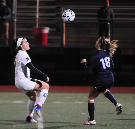 JIM VAIKNORAS/Staff photo Newburyport's Samantha Kelleher fights for the ball with Swampscott's Emerson Laundry at Manning Field in Lynn Sunday Night.
